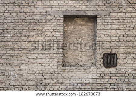 Old gungy wall with window - stock photo