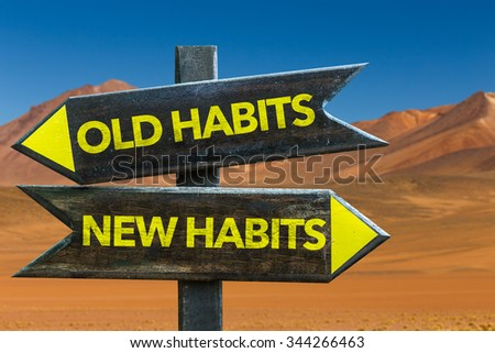 Old Habits - New Habits signpost in a desert background - stock photo