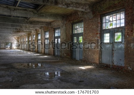 Old Hall of the abandoned post - stock photo