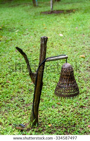 Old hand made wooden lamp made from bamboo in the garden. - stock photo
