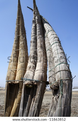 old handmade totora boat in trujillo peru south america - stock photo