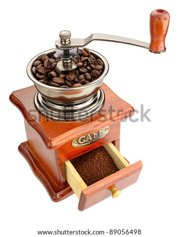 Old handmill with coffee beans and open coffee box against white background - stock photo