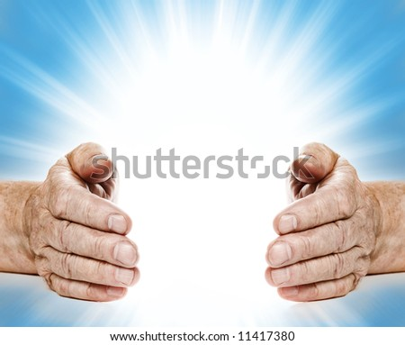 Old hands on abstract background - stock photo