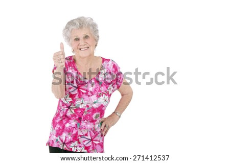 Old happy woman doing a thumb up gesture against a white background - stock photo