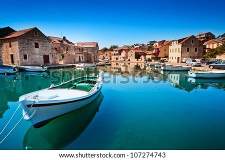 Old harbor at Adriatic sea. Hvar island, Croatia, popular touristic destination - stock photo