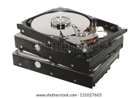 old hard drives stacked isolated on white background - stock photo
