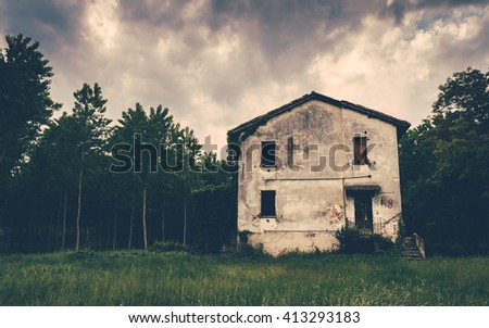 Old haunted house in the woods [REVIEWERS: NO PROPERTY RELEASE AS IT IS AN ABANDONED HOUSE, FIXED FOR FOCUS] - stock photo