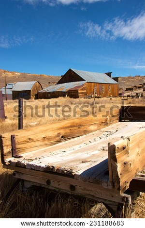 Old hay wagon in historic town of Bodie, California - stock photo