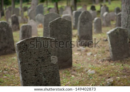 Old headstones in a rural cemetery  - stock photo