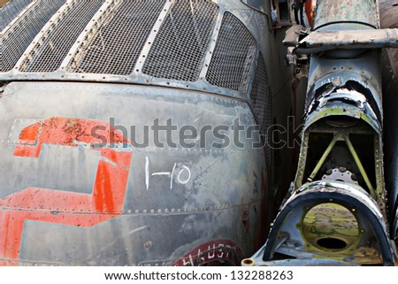 Old helicopters parts in a junkyard near Tuscon Arizona - stock photo