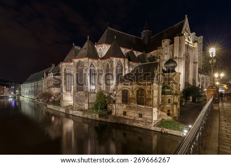Old historic center of city of Ghent at Belgium in blue hour view on the Sint Michiels bridge - stock photo