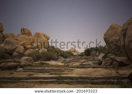 Old historic place called Hampi in Karnataka state in India at night. - stock photo
