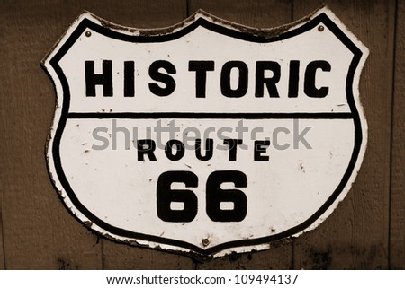 Old historic route 66 sign in sepia - stock photo