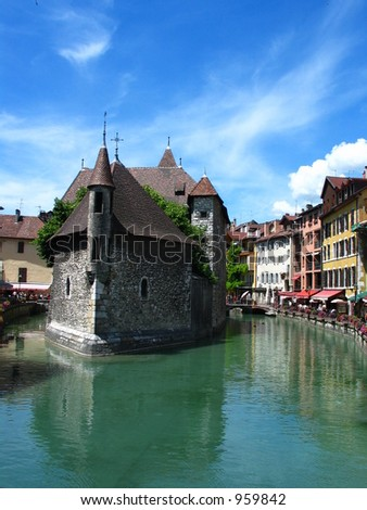Old historical building against blue sky - stock photo