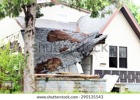 Old home where the roof has collapsed. - stock photo