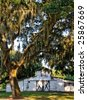Old Horse barn with Oak trees and Spanish moss - stock photo