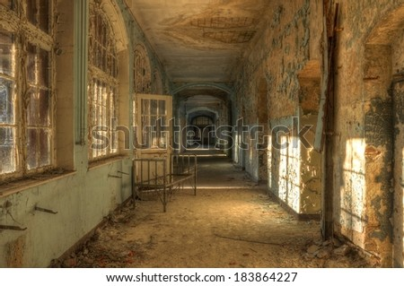 Old Hospital bed in a deserted corridor - stock photo