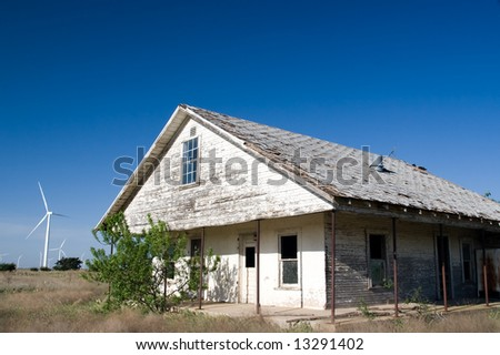 Old House and Wind Power - stock photo