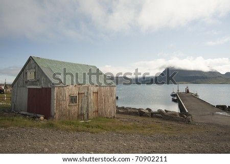 Old house at sea in North west Iceland - stock photo