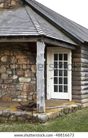 Old house built from stone and logs located at Theodore Roosevelt State park, Montauk, Long Island, New York. - stock photo