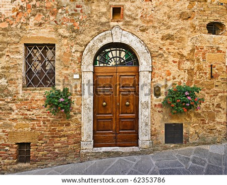 Old house door, Pienza, Tuscany, Italy - stock photo