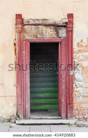 Old house doorway with green stairs - stock photo