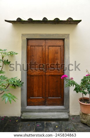 Old house enter with flowered, Italy - stock photo