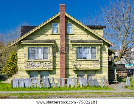 Old House in Disrepair - stock photo