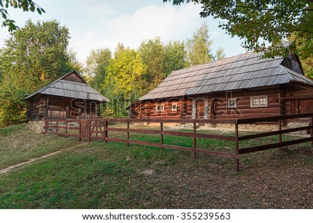 Old house of the peasants and the fence at the Museum of Pirogovo. Ukraine - stock photo