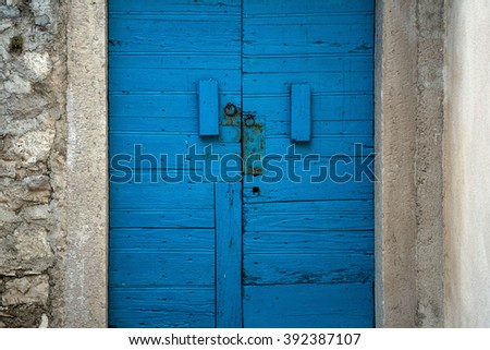 Old house with blue door  - stock photo