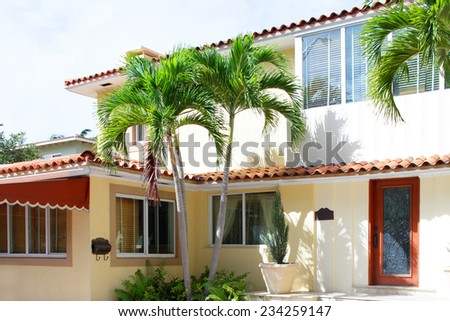 Old house with palm trees in Miami Beach - stock photo