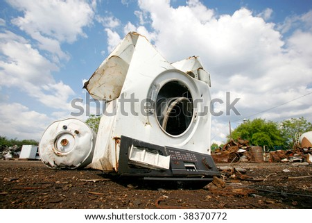 Old household appliances disposed of in metal scrapyard - stock photo