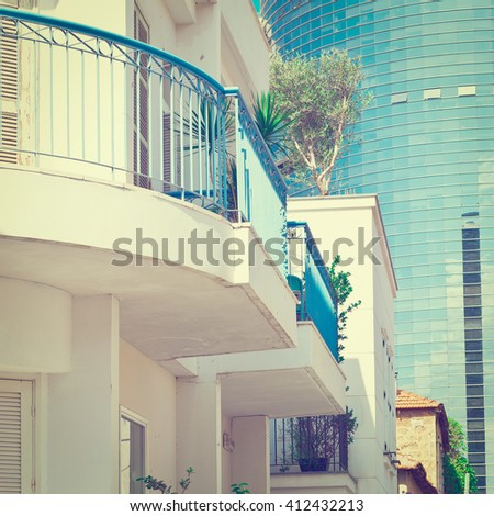 Old Houses after Reconstruction in Tel Aviv on the Background of the Modern Building, Instagram Effect - stock photo