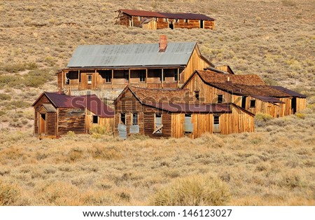 Old houses and buildings in Bodie State Historic Park. Bodie is a vey well preserved ghost town in California, USA. - stock photo