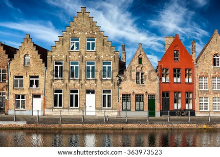 Old houses and canal in Bruges (Brugge) on sunset, Belgium - stock photo