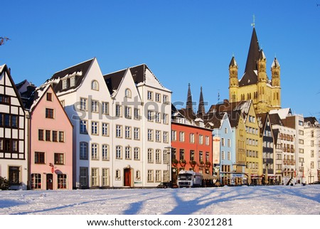 Old houses and Church of Saint Martin in Cologne - stock photo