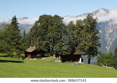 Old Houses in the alps in the Bernese Oberland, Switzerland - stock photo
