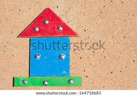 Old houses on corckboard. Concept photo of Real estate market bubble , booming, money,price, grid, home, rent, house, housing, industry and subprime mortgage crisis. (Copy Space) - stock photo