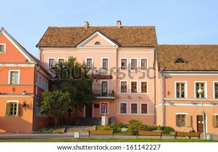 Old houses on embankment, Troetskae pradmestse - an old town in Minsk, Belarus - stock photo
