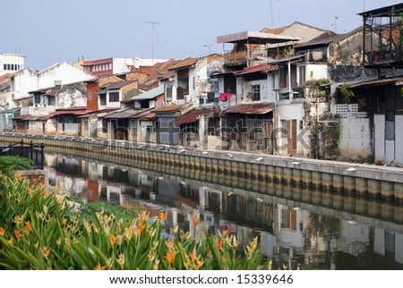 Old houses on the river in Melaka, Malaysia - stock photo