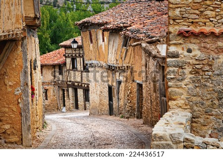 Old houses, typical medieval architecture in Calatanazor, Soria, Spain - stock photo