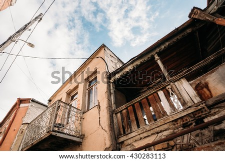 Old Houses With Balconies In The Old Part Of Tbilisi - The Capital Of Georgia. Dilapidated House. - stock photo