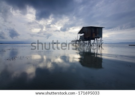 Old hut on a gloomy weather at Sabah, Borneo, Malaysia - stock photo