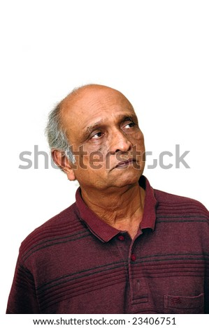 Old Indian Immigrant thinking about something very seriously - stock photo