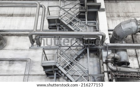 Old industrial interior in shades of gray - stock photo