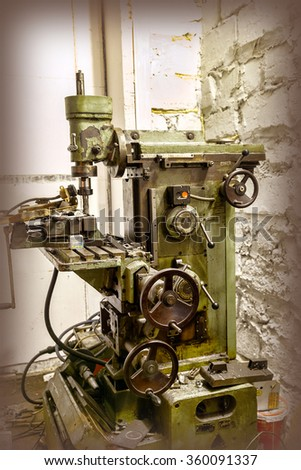 Old industrial milling machine - stock photo