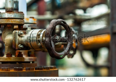 Old industrial water supply parts at power plant - stock photo