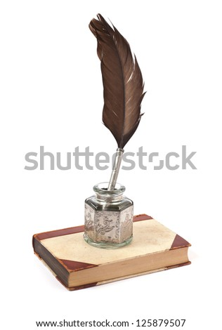 old ink pen and book - stock photo