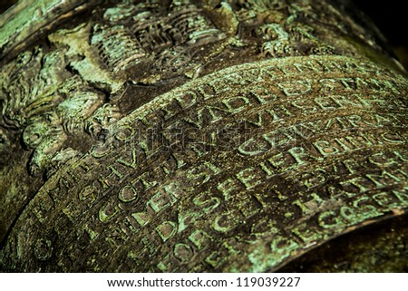 old inscriptions maded on metal - stock photo