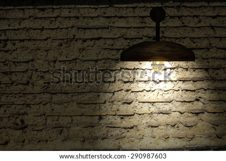 Old interior room with brick wall and three light spots for adv or others purpose use - stock photo